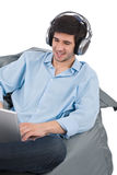 Young businessman relax with music and laptop Stock Images