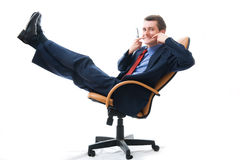 Young businessman relaxed in chair. Stock Images