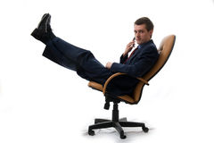 Young businessman relaxed in chair. Royalty Free Stock Photos