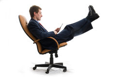 Young businessman relaxed in chair. Stock Image