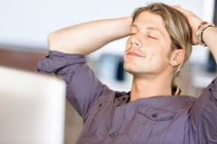 The young businessman relaxed Stock Image