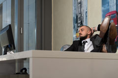 Young Businessman Relaxes In His Office Stock Images