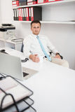 Young Businessman Relaxes Sitting In The Office Royalty Free Stock Images