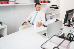 Young Businessman Relaxes Sitting In The Office Royalty Free Stock Photography