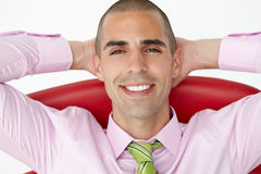 Young businessman relaxing in chair Stock Photos