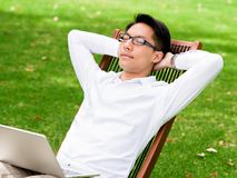 Young businessman relaxing during his break in park Royalty Free Stock Image
