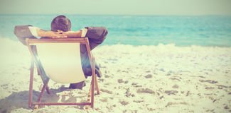 Young businessman relaxing on his sun lounger Royalty Free Stock Photos