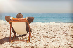 Young businessman relaxing on his sun lounger Royalty Free Stock Image