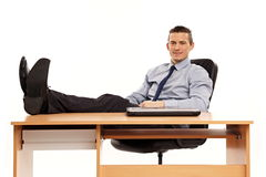 Young businessman relaxing at work Royalty Free Stock Photos