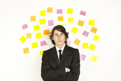 Young businessman with reminder notes Royalty Free Stock Photos
