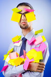 Young businessman with reminders Stock Photo
