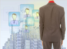 Young businessman with rendered city skyline Stock Image