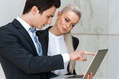 Businessman reviewing work with female colleague. Royalty Free Stock Photo
