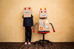 Young businessman with robot Royalty Free Stock Images