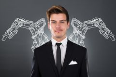 Businessman With Robotic Arms. Young Businessman With Robotic Arms On Background stock image