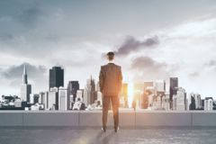 Young businessman on rooftop Royalty Free Stock Images