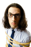 Young businessman  with rope Stock Photo