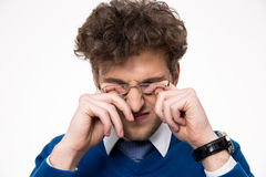 Young businessman rubbing his eyes Stock Images