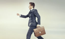 Young businessman running into his career stock image