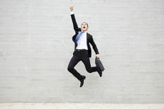 Young businessman running and jumping stock photos