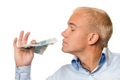 A young businessman with russian money the hands Stock Image