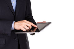 Young businessman's hands with tablet pc. Young businessman's hands working on tablet pc isolated on white Royalty Free Stock Photos