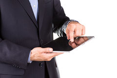Young businessman's hands with tablet pc Stock Image