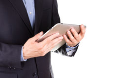 Young businessman's hands with tablet pc. Young businessman's hands working on tablet pc isolated on white Royalty Free Stock Image