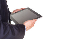 Young businessman's hands with tablet pc. Young businessman's hands working on tablet pc isolated on white Royalty Free Stock Photo