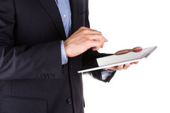 Young businessman's hands working on a tablet pc comuter Stock Photos