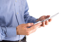 Young businessman's hands working on a tablet pc comuter Stock Images