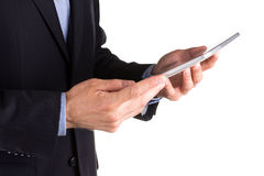 Young businessman's hands working on a tablet pc comuter Royalty Free Stock Photos