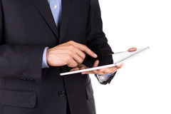 Young businessman's hands working on a tablet pc comuter Stock Photo