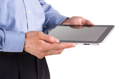 Young businessman's hands working on a tablet pc comuter Royalty Free Stock Image