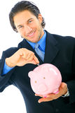 Young Businessman Saving Money Royalty Free Stock Photos