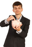 Young businessman saving money Royalty Free Stock Image