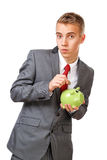 Young businessman saving money Royalty Free Stock Photo