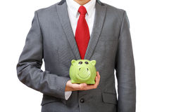 Young businessman saving money Stock Photo