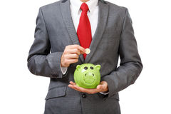 Young businessman saving money Royalty Free Stock Images