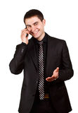 Young businessman says cheerfully cal Royalty Free Stock Images