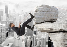 Young businessman scaling a rock Royalty Free Stock Photo