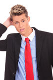 Young businessman scratching his head Royalty Free Stock Photo