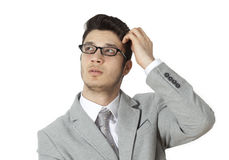 Young businessman scratching his head Stock Image