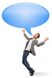 Young businessman screaming with a bubble chat Stock Photography