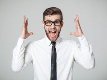 Young businessman screaming at camera isolated. Royalty Free Stock Photography