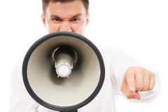 A young businessman screaming on a megaphone Royalty Free Stock Photos