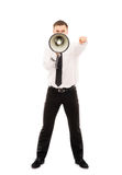 Young businessman screaming with a megaphone. Angry businessman boss screaming with a megaphone isolated on white Stock Image