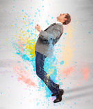 Young businessman screaming on splash colored Stock Image