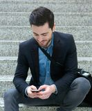 Young businessman sending text message Stock Photography