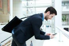 Young businessman sending text message Stock Photos